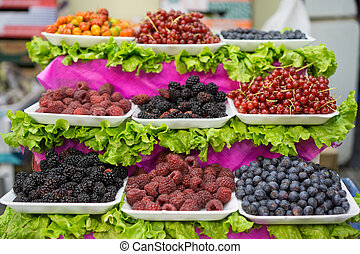 Berries trays in the market, focus on foreground - Detail