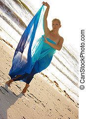 tempting muse - a blonde ballerina wrapped in blue silk is...