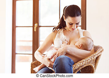 Mother breastfeeding her baby - Mother breastfeeding her...