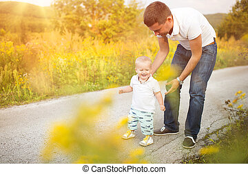 Father and son enjoying life together outside - Father and...