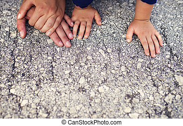 Young family - Hands of parents with their kids laid on the...