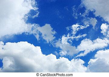 blue sky and clouds - Cumulus clouds hung in the blue sky