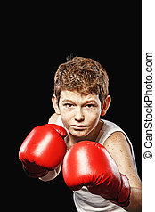 Stern look boxer - Red-haired boy on a black background with...