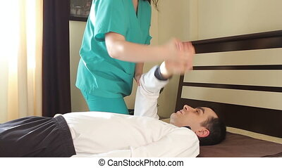 Therapeutic exercises to arms - Physical therapist doing...