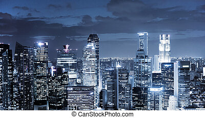 skyline at night - panoramic view of illuminated skyscrapers...