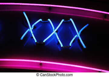 XXX neon sign advertising an adult licensed sex shop in a...