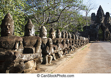 Angkor Tom entrance - Gate of the largest city capital named...