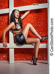 Girl in leather skirt. - Girl in leather skirt with straps...