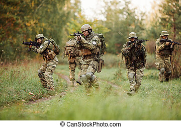 group of soldiers engaged in the exploration area - group of...