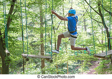 Man jumping while climbing in high rope course