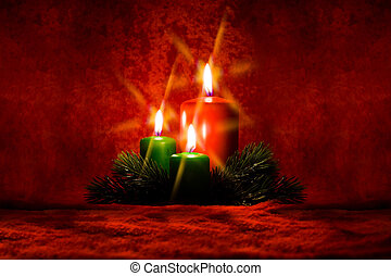 Burning candle with Christmas decorations of the cross...