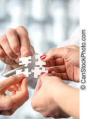 Four hands fitting together matching interlocking puzzle...