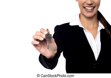 Property agent showing key. - Cropped image of realtor...