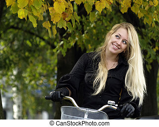 Young woman on bicylce - Young beautiful blond woman on...