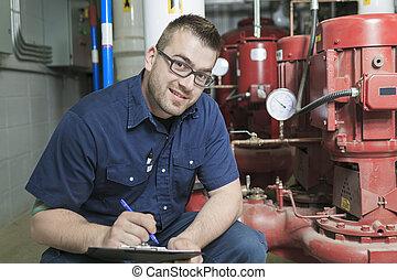 A good serviceman working on a machine room