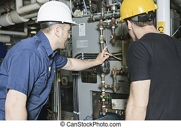 repairman engineer or inspector who check the system