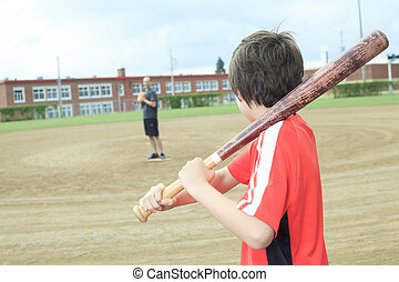 Portrait of a young baseball player in a field