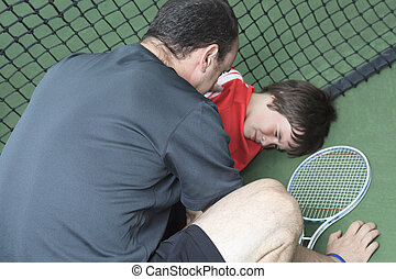 boy tennis player who having a injury - A boy tennis boy...