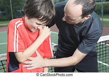 boy tennis player who having a injury - A boy tennis boy...
