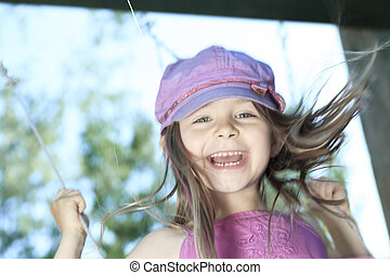 a little girl spending time outdoor on a warm summer day