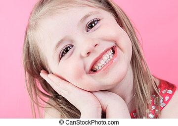 A cute fashion little doll girl in pink background