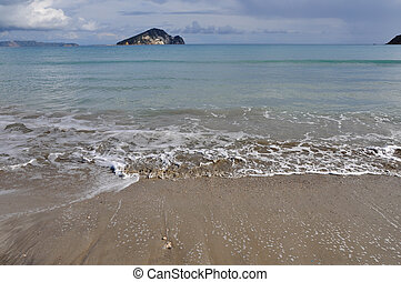 waves on sandy beach - Waves splashing on sandy beach Keri...