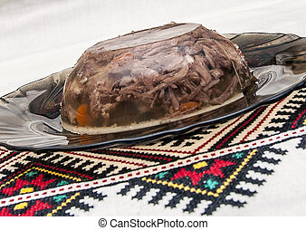meat aspic - jellied meat on national tablecloths