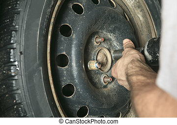 A man who changing a Car Tire