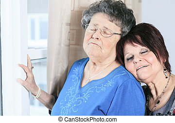 A senior grandmother with is daughter having great time in...