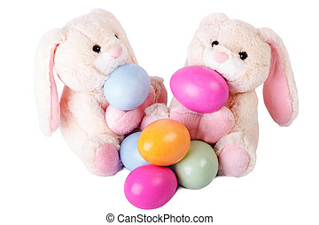 Two rabbits with easter eggs on white background