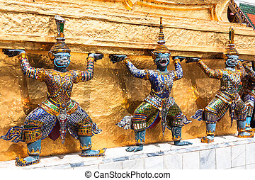 Guards on the base level of stupa in Wat Phra Keo, Thailand
