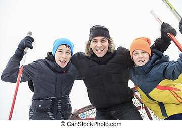 A family playing at the skating rink in winter