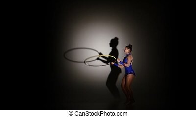 woman exercising Rhythmic Gymnastics hula hoop, slow motion...