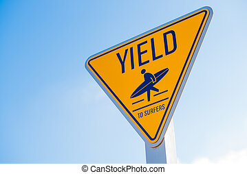 Yield to surfer sign in Southern California - A yellow yield...