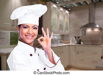 Chef woman. - Smiling Chef woman in the modern kitchen