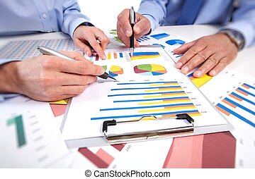 Hands of business people working in office with documents.