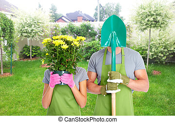 Gardening people Couple with flowers in the garden