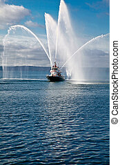 Fireboat - A fireboat casting water stream at open water
