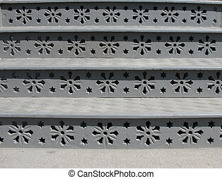 Cast iron steps with floral ornaments