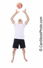 Young man playing volleyball. Studio shot over white.
