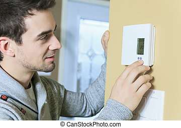A man set the thermostat at house