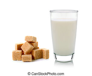 glass of milk and cubes of cane sugar isolated on white...
