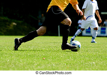 soccer player - a soccer player in action