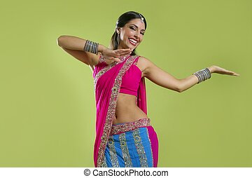 Beautiful indian young brunette woman dancing - Brunette...