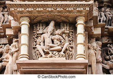 Stone carved, Khajuraho - Stone carved erotic bas relief in...