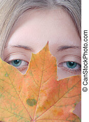 The girl with maple autumn sheet