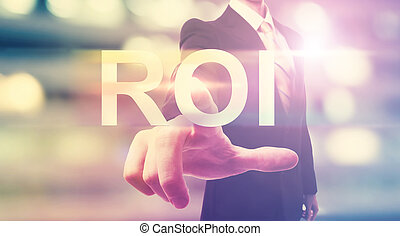Businessman pointing at ROI return on investment on blurred...
