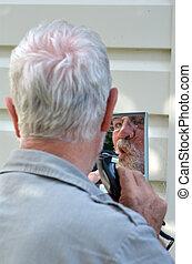 Man trim his beard - Mature man trim his beard outdoor...
