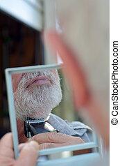 Man trim his beard - Close up of a mature man trim his beard...