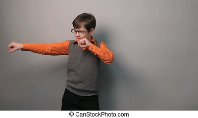 teenager boy dancing funny waving his arms in glasses ten...